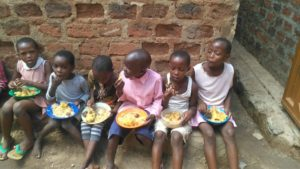 Children eating a meal.